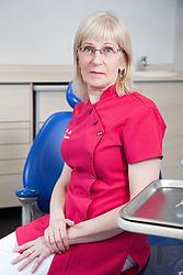 Dr. Elle Tigasson